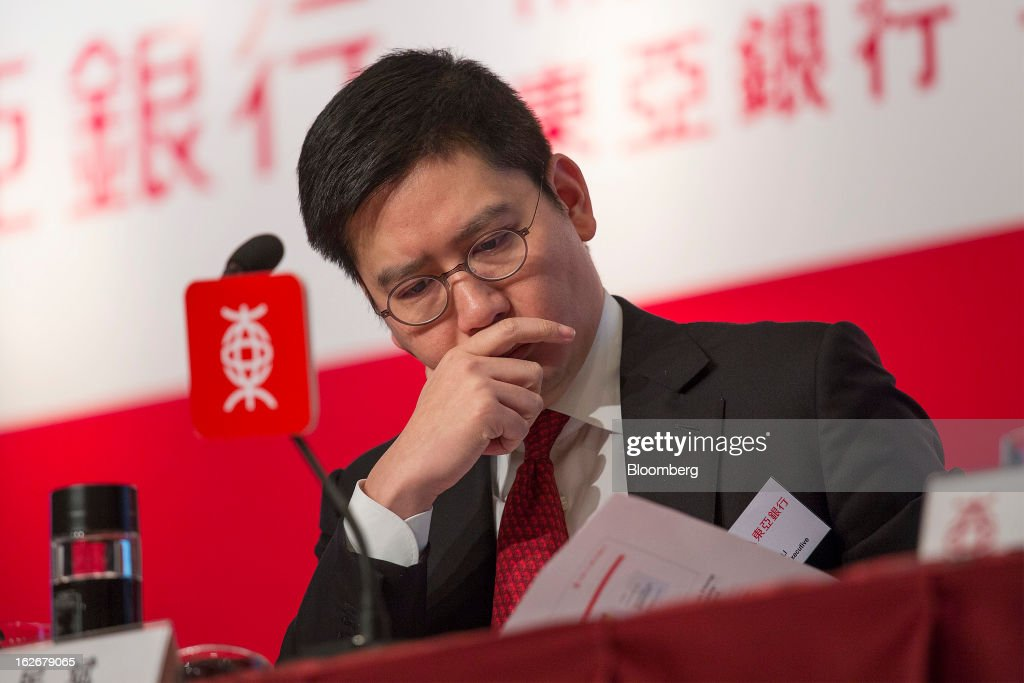 Brian Li, deputy chief executive officer of Bank of East Asia Ltd. (BEA), looks at paperwork during the company's annual results news conference in Hong Kong, China, on Tuesday, Feb. 26, 2013. Bank of East Asia, Hong Kong's largest family-run lender, said 2012 profit jumped 39 percent as trading income climbed, helping offset a decline in profit from the mainland China business. Photographer: Jerome Favre/Bloomberg via Getty Images