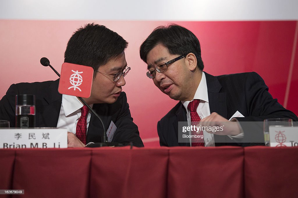 Brian Li, deputy chief executive officer of Bank of East Asia Ltd. (BEA), left, speaks with Tong Hon Shing, chief operating officer, during the company's annual results news conference in Hong Kong, China, on Tuesday, Feb. 26, 2013. Bank of East Asia, Hong Kong's largest family-run lender, said 2012 profit jumped 39 percent as trading income climbed, helping offset a decline in profit from the mainland China business. Photographer: Jerome Favre/Bloomberg via Getty Images