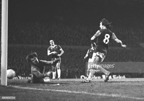 Brian Little Aston Villa No8 slams the ball into the net beating Everton's diving goalkeeper David Lawson to score the winning goal just two minutes...