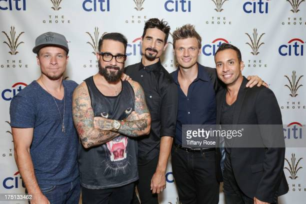 Brian Littrell AJ McLean Kevin Richardson Nick Carter and Howie Dorough of the Backstreet Boys pose at The Grove on July 31 2013 in Los Angeles...