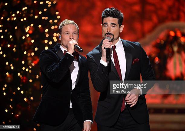Brian Littrell and Kevin Richardson of the Backstreet Boys perform onstage at TNT Christmas in Washington 2013 at the National Building Museum on...