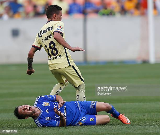 Brian Lozano of Club America fouls Jose Torres of Tigres UANL in the second half at BBVA Compass Stadium on March 26 2016 in Houston Texas