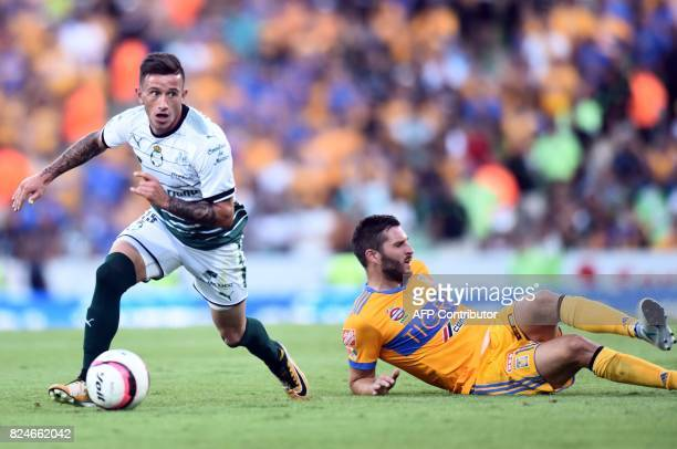 Brian Lozano of Santos vies for the ball with Andre Gignac of Tigres during their Mexican Apertura 2017 Tournament football match at the TSM Corona...