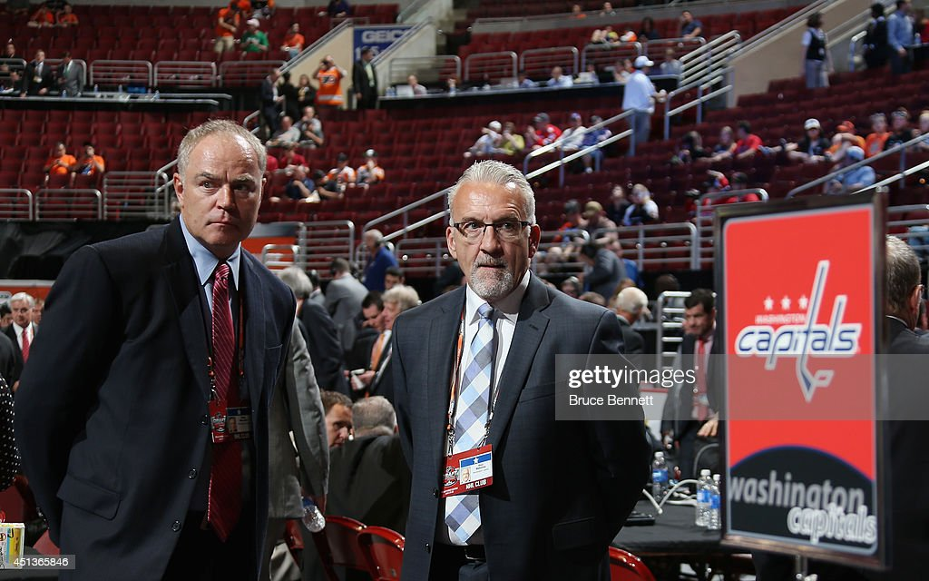Brian MacLellan, senior vice president and general manager is seen alongside Ross Mahoney, assistant general manager of the Washington Capitals, prior to the start of the first round of the 2014 NHL Draft at the Wells Fargo Center on June 27, 2014 in Philadelphia, Pennsylvania.