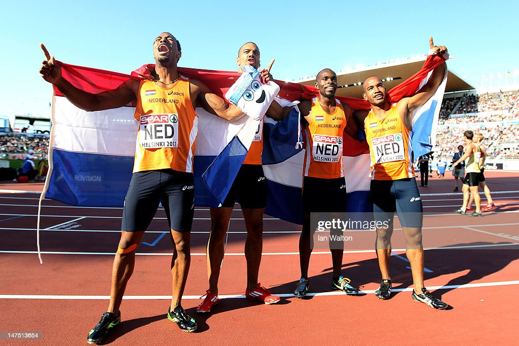 Brian Mariano Patrick van Luijk Churandy Martina and Giovanni Codrington of the Netherlands celebrate winning gold in the Men's 4x100 Metres Relay...