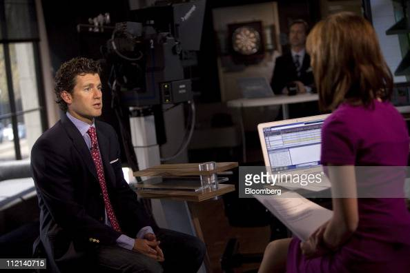 Brian Marshall analyst for Gleacher Co Securities left speaks during a Bloomberg West television interview in San Francisco California US on Tuesday...