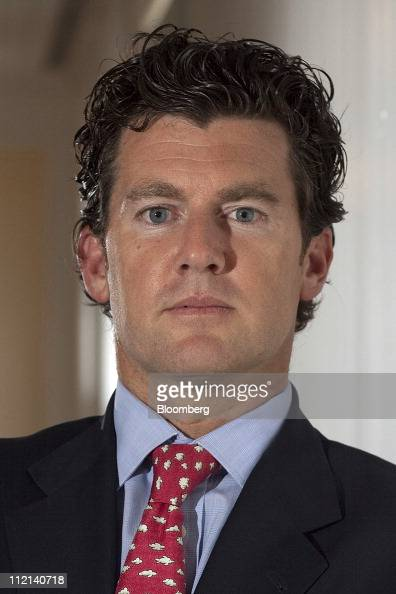 Brian Marshall analyst for Gleacher Co Securities stands for a photograph after a Bloomberg West television interview in San Francisco California US...