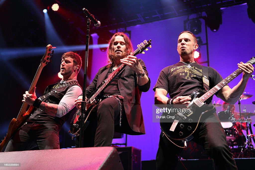 Brian Marshall Myles Kennedy and Mark Tremonti of Alter Bridge perform on stage at Wembley Arena on October 18 2013 in London England