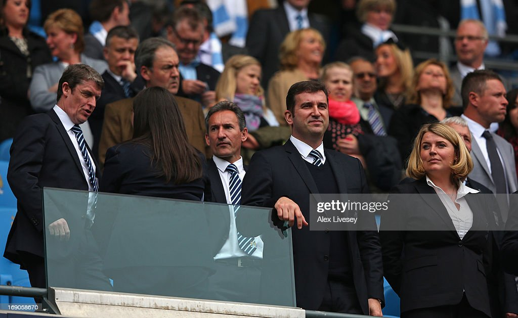 Brian Marwood, Txiki Begiristain the Director of Football at Manchester City, Ferran Soriano the CEO and Vicky Kloss the chief communications officer of Manchester City look on prior to the Barclays Premier League match between Manchester City and Norwich City at Etihad Stadium on May 19, 2013 in Manchester, England.