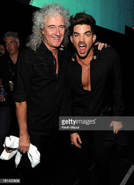 Brian May and Adam Lambert attend the iHeartRadio Music Festival at the MGM Grand Garden Arena on September 20 2013 in Las Vegas Nevada