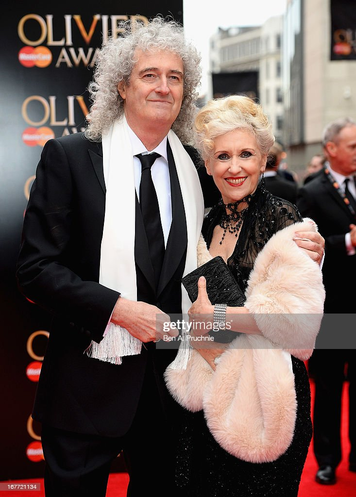 Brian May and Anita Dobson attends The Laurence Olivier Awards at the Royal Opera House on April 28, 2013 in London, England.