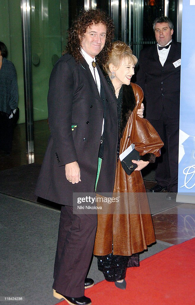 Brian May and Anita Dobson during 2006 Laurence Olivier Awards - Arrivals at London Hilton in London, United Kingdom.