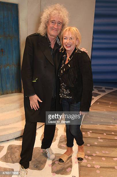 Brian May and producer Judy Craymer pose backstage following the debut performance of the new West End company of Mamma Mia at the Novello Theatre on...