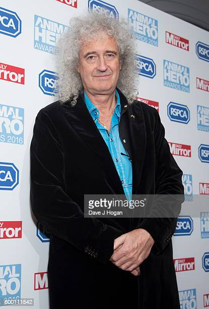 Brian May arrives with his pet dog for Daily Mirror and RSPCA Animal Hero Awards at Grosvenor House on September 7 2016 in London England