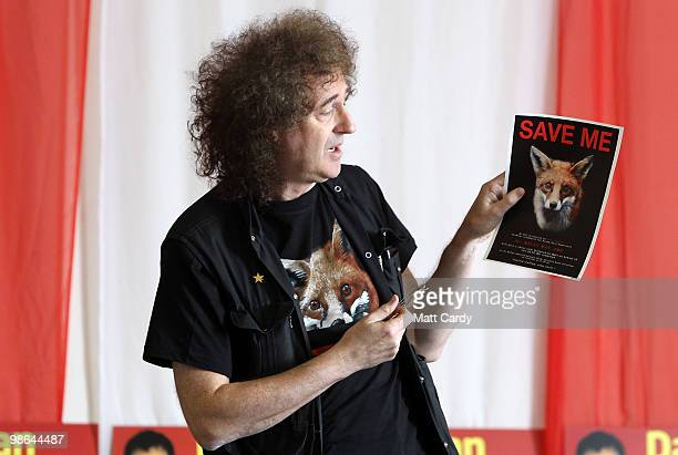 Brian May founding member of the rock band Queen holds up a antifox hunting poster at the Royal British Legion on April 24 2010 in Keynsham England...