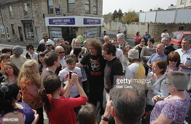 Brian May founding member of the rock band Queen speaks with people outside a cafe on the High Street on April 24 2010 in Midsomer Norton England The...