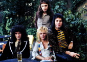 Brian May John Deacon Roger Taylor and Freddie Mercury of British rock group Queen at Les Ambassadeurs where they were presented with silver gold and...