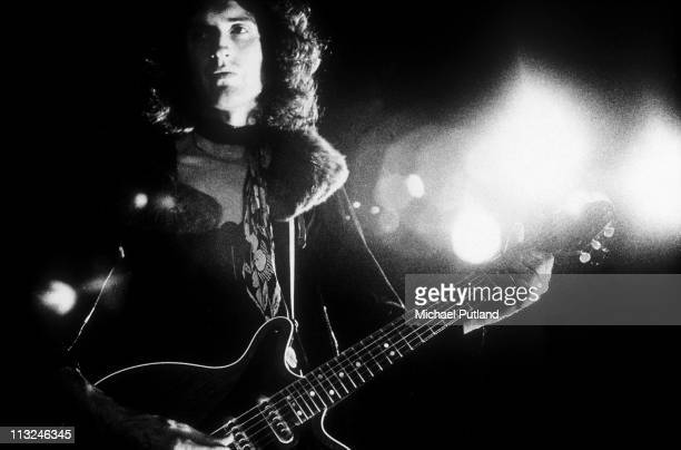 Brian May of Queen performs on stage London 1974