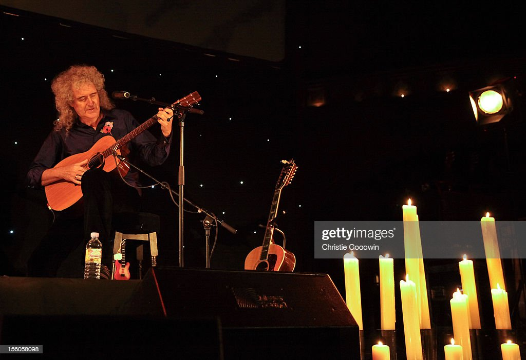 <a gi-track='captionPersonalityLinkClicked' href=/galleries/search?phrase=Brian+May&family=editorial&specificpeople=158059 ng-click='$event.stopPropagation()'>Brian May</a> performs on stage by candelight as part of the Kerry Ellis & <a gi-track='captionPersonalityLinkClicked' href=/galleries/search?phrase=Brian+May&family=editorial&specificpeople=158059 ng-click='$event.stopPropagation()'>Brian May</a> Born Free Tour at the Union Chapel on November 11, 2012 in London, England.