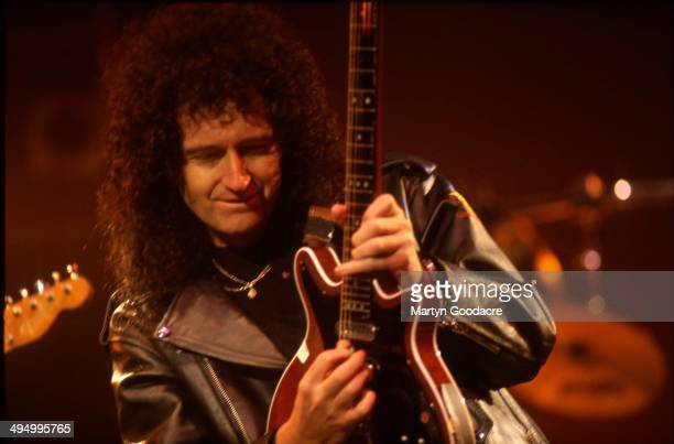 Brian May performs on stage with Status Quo Brixton London United Kingdom 1996