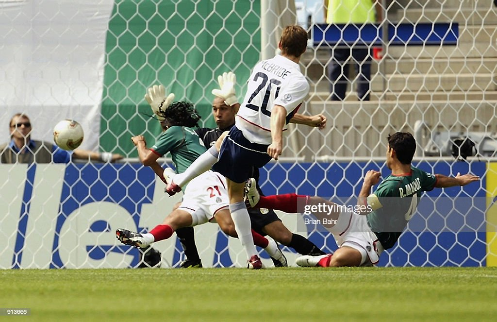 Brian McBride of the USA shoots past (L to R) Jesus Arellano, Oscar Perez and Rafael Marquez during the Mexico v USA, World Cup Second Round match played at the Jeonju World Cup Stadium, Jeonju, South Korea on June 17, 2002. The USA won 2-0.