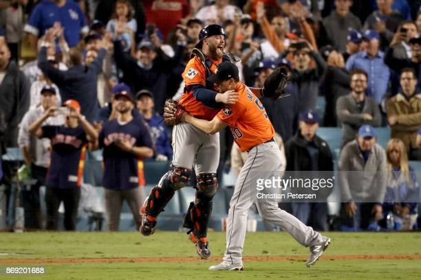 Brian McCann and Charlie Morton of the Houston Astros celebrate after defeating the Los Angeles Dodgers in game seven with a score of 5 to 1 to win...