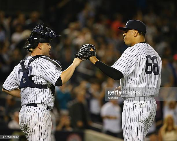 Brian McCann and Dellin Betances of the New York Yankees celebrate a 21 win against the Miami Marlins after their game at Yankee Stadium on June 17...