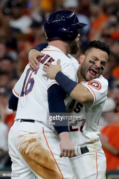 Brian McCann and Jose Altuve of the Houston Astros celebrate after hitting a double to right field to score Carlos Correa and Yuli Gurriel against...
