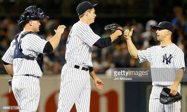 Brian McCann Andrew Miller and Brett Gardner of the New York Yankees celebrate after defeating the Tampa Bay Rays at Yankee Stadium on September 4...