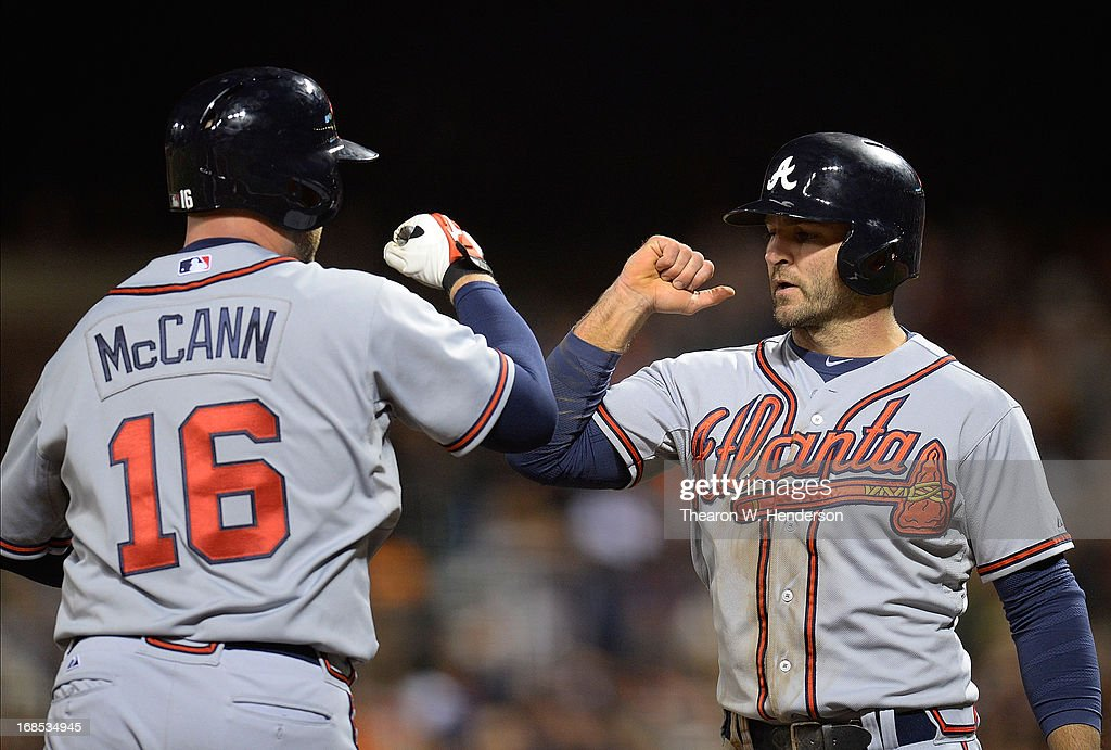 <a gi-track='captionPersonalityLinkClicked' href=/galleries/search?phrase=Brian+McCann+-+Baseball+Player&family=editorial&specificpeople=593065 ng-click='$event.stopPropagation()'>Brian McCann</a> #16 of the Atlanta Brave is congratulated by <a gi-track='captionPersonalityLinkClicked' href=/galleries/search?phrase=Dan+Uggla&family=editorial&specificpeople=542208 ng-click='$event.stopPropagation()'>Dan Uggla</a> #26 after McCann hit a two-run homer against the San Francisco Giants in the fifth inning at AT&T Park on May 10, 2013 in San Francisco, California.