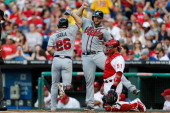 Brian McCann of the Atlanta Braves congratulates Dan Uggla after Uggla hit a tworun home run in the second inning of the game against the...