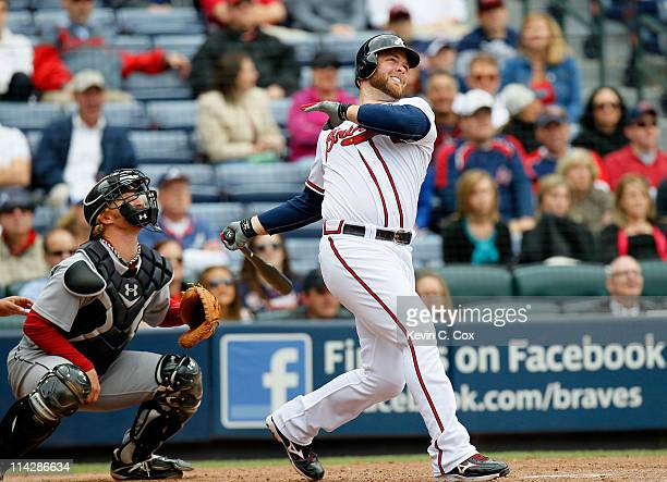 Brian McCann of the Atlanta Braves hits a walkoff tworun homer in the 11th inning against the Houston Astros at Turner Field on May 17 2011 in...