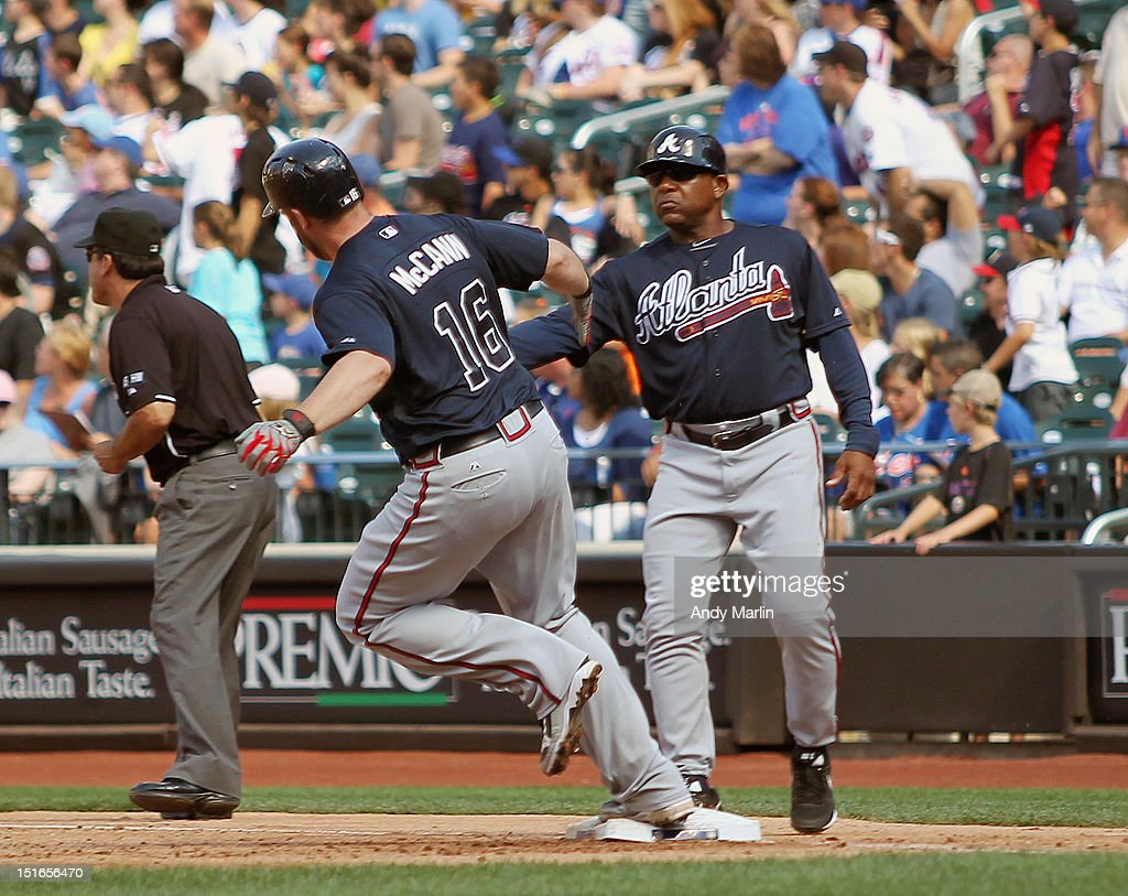 Brian McCann #16 of the Atlanta Braves is congratulated by first base coach Terry Pendleton #9 after hitting a sixth inning home run against the New York Mets at Citi Field on September 9, 2012 in the Flushing neighborhood of the Queens borough of New York City.