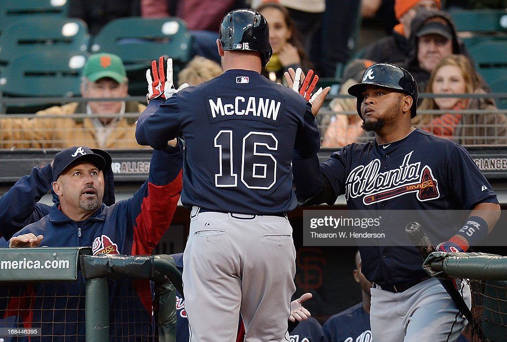 <a gi-track='captionPersonalityLinkClicked' href=/galleries/search?phrase=Brian+McCann+-+Baseball+Player&family=editorial&specificpeople=593065 ng-click='$event.stopPropagation()'>Brian McCann</a> #16 of the Atlanta Braves is congratulated by Juan Francisco #25 (R) and manager <a gi-track='captionPersonalityLinkClicked' href=/galleries/search?phrase=Fredi+Gonzalez&family=editorial&specificpeople=686896 ng-click='$event.stopPropagation()'>Fredi Gonzalez</a> #33 (L) after McCann hit a two-run homer against the San Francisco Giants in the second inning at AT&T Park on May 9, 2013 in San Francisco, California. Uggla scored in front of McCann on the homer.