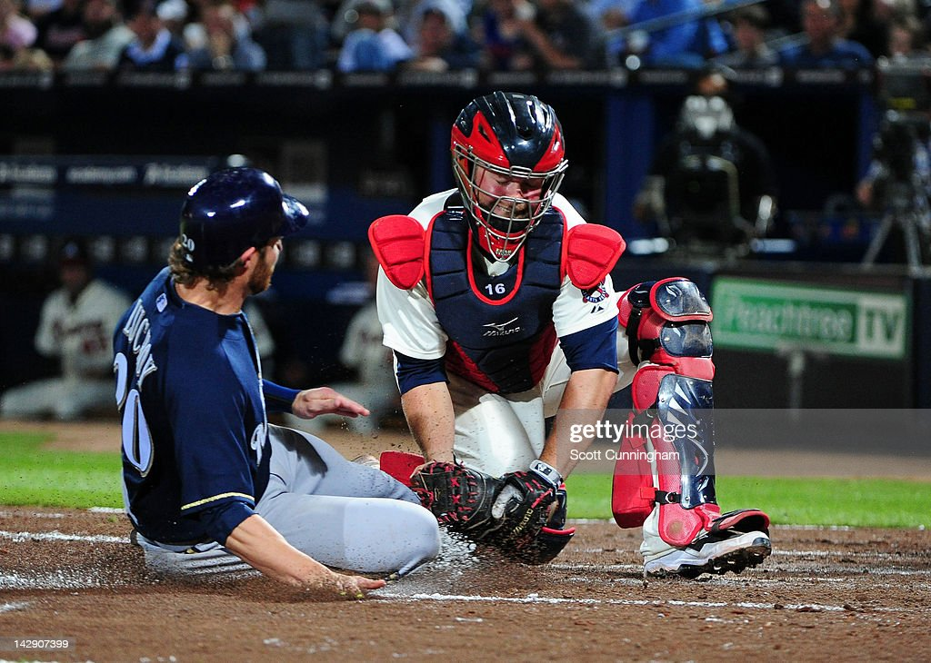 <a gi-track='captionPersonalityLinkClicked' href=/galleries/search?phrase=Brian+McCann+-+Baseball+Player&family=editorial&specificpeople=593065 ng-click='$event.stopPropagation()'>Brian McCann</a> #16 of the Atlanta Braves is tags out <a gi-track='captionPersonalityLinkClicked' href=/galleries/search?phrase=Jonathan+Lucroy&family=editorial&specificpeople=5732413 ng-click='$event.stopPropagation()'>Jonathan Lucroy</a> #20 the Milwaukee Brewers at Turner Field on April 14, 2012 in Atlanta, Georgia.