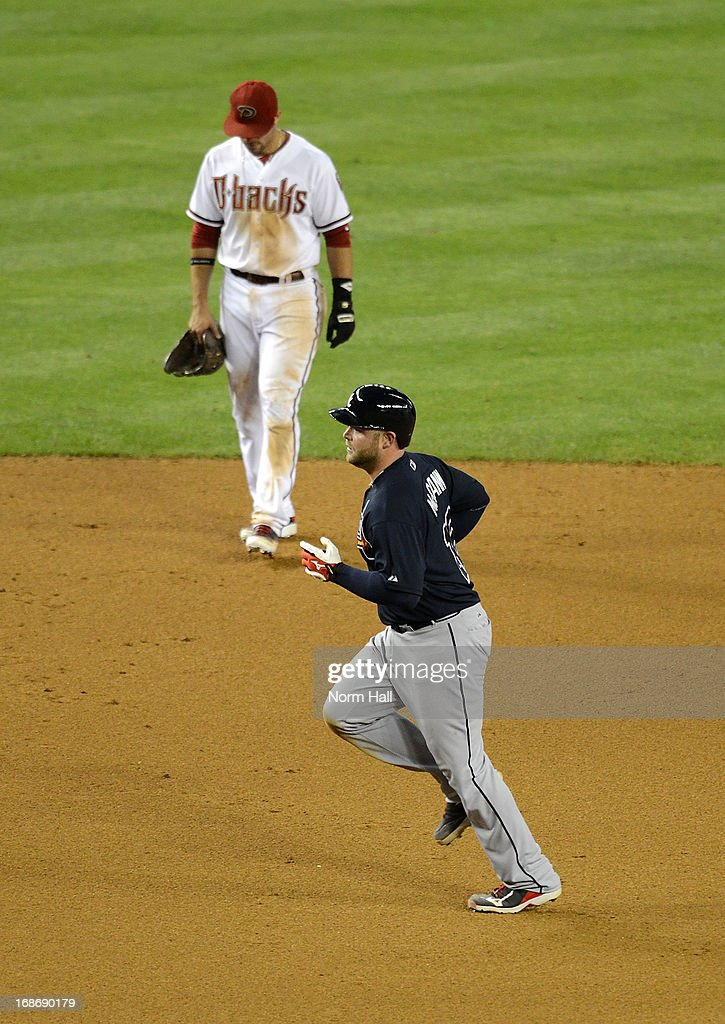 <a gi-track='captionPersonalityLinkClicked' href=/galleries/search?phrase=Brian+McCann+-+Baseball+Player&family=editorial&specificpeople=593065 ng-click='$event.stopPropagation()'>Brian McCann</a> #16 of the Atlanta Braves rounds the bases after hitting a home run against the Arizona Diamondbacks at Chase Field on May 13, 2013 in Phoenix, Arizona.