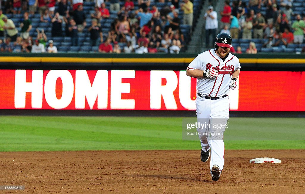 <a gi-track='captionPersonalityLinkClicked' href=/galleries/search?phrase=Brian+McCann&family=editorial&specificpeople=593065 ng-click='$event.stopPropagation()'>Brian McCann</a> #16 of the Atlanta Braves rounds the bases after hitting a three run home run in the third inning against the Cleveland Indians at Turner Field on August 29, 2013 in Atlanta, Georgia.