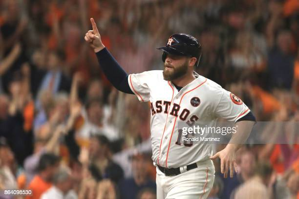 Brian McCann of the Houston Astros celebrates after scoring off of a single hit by Jose Altuve against Luis Severino of the New York Yankees during...