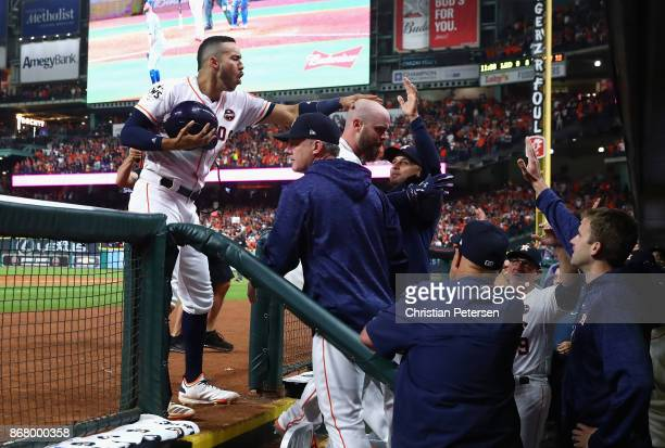 Brian McCann of the Houston Astros celebrates with teammates after hitting a solo home run during the eighth inning against the Los Angeles Dodgers...