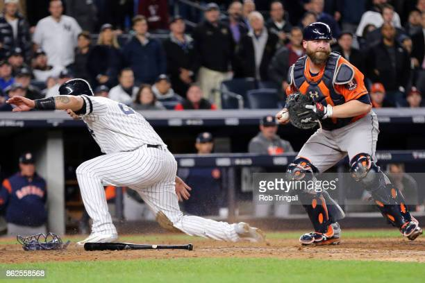 Brian McCann of the Houston Astros forces out Gary Sanchez of the New York Yankees at home during Game 4 of the American League Championship Series...