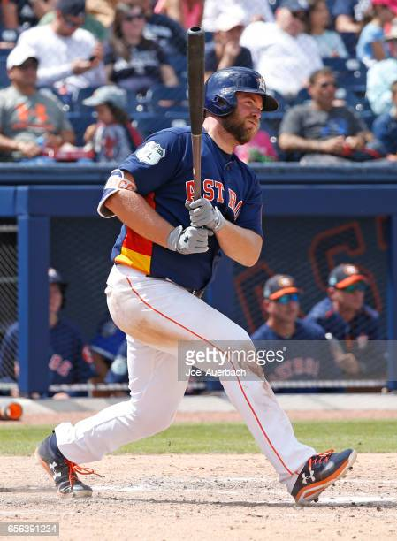 Brian McCann of the Houston Astros hits a single against the New York Yankees in the fourth inning during a spring training game at The Ballpark of...