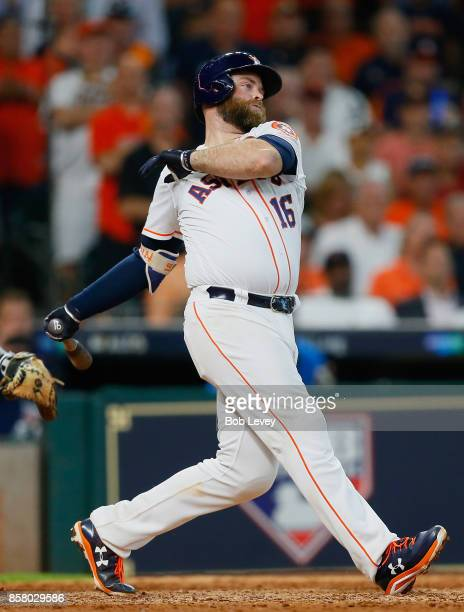 Brian McCann of the Houston Astros hits a tworun RBI single in the sixth inning against the Boston Red Sox during game one of the American League...