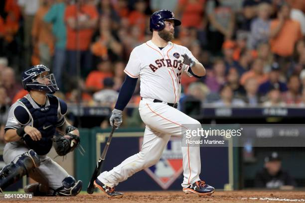 Brian McCann of the Houston Astros hits an RBI double to score Alex Bregman against Luis Severino of the New York Yankees during the fifth inning in...