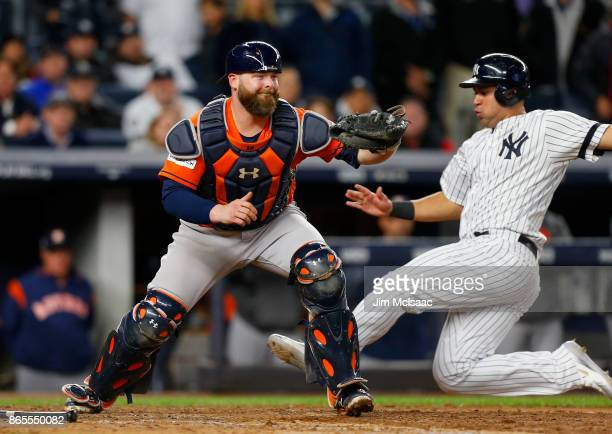 Brian McCann of the Houston Astros in action against Gary Sanchez of the New York Yankees in Game Four of the American League Championship Series at...