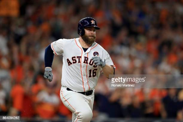 Brian McCann of the Houston Astros runs after hitting an RBI double to score Alex Bregman against Luis Severino of the New York Yankees during the...