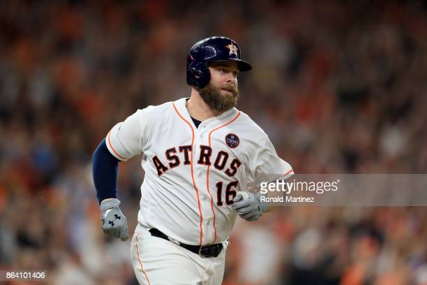 Brian McCann of the Houston Astros runs to second base after hitting an RBI double to score Alex Bregman against Luis Severino of the New York...