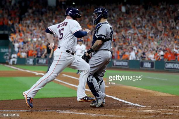 Brian McCann of the Houston Astros scores off of a single hit by Jose Altuve against Luis Severino of the New York Yankees during the fifth inning in...