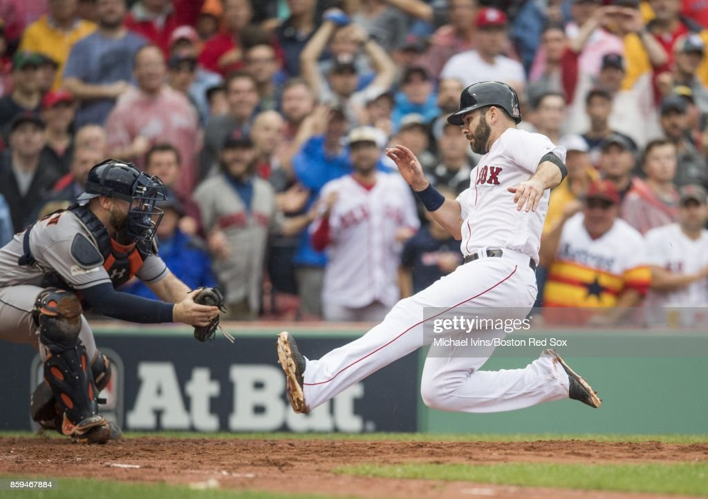 Brian McCann #16 of the Houston Astros tags out Mitch Moreland #18 of the Boston Red Sox in the third inning of game four of the American League Division Series at Fenway Park on October 9, 2017 in Boston, Massachusetts.