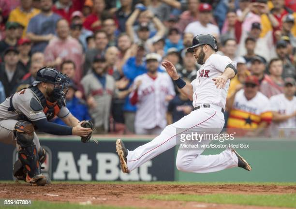 Brian McCann of the Houston Astros tags out Mitch Moreland of the Boston Red Sox in the third inning of game four of the American League Division...