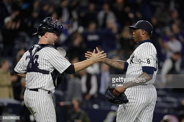 Brian McCann of the New York Yankees and Aroldis Chapman celebrate a 107 win against the Kansas City Royals during their game at Yankee Stadium on...